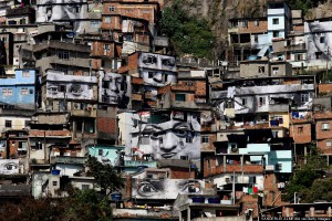 "General view of the ""Morro da Providencia"" favela, one of the most violent of Rio de Janeiro, Brazil, taken on August 20, 2008. The French photographer identified as JR is launching a project called ""Women Are Heroes"", through which the photographs of women, relatives of the victims of clashes between the police and drug traffickers, were placed in the facades of the houses. This project already took place in Sudan, Sierra Leone, Kenya and Liberia, and will be taken to India, Cambodia, Laos and Morocco after Brazil. AFP PHOTO/VANDERLEI ALMEIDA (Photo credit should read VANDERLEI ALMEIDA/AFP/Getty Images)"