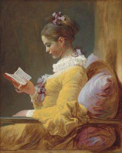 Side view of a half-length figure of a girl in a yellow dress reading a book