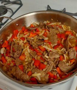 Pepper Steak on a stove