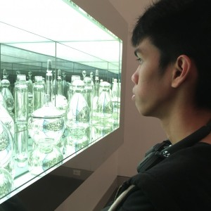 My friend looking at the art piece.
