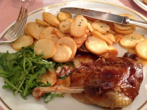 My own example of food photography: Duck confit and potatoes at Brasserie Mollard in Paris
