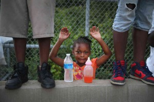 Scott Olson, Gabrielle Walker, 5, protests the killing of Michael Brown, August 17, 2014