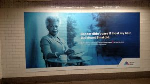A photograph taken in the 42nd Street subway. Image of a women who found excellent cancer treatment at Mount Sinai Hospital.