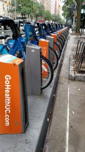 "This photo was shot in New York City and captures a row of city bikes that have been branded with Northwell's urgent care ""GoHealthUC.com."" It demonstrates how every commercial space can be branded and how area healthcare organizations make their expanding services known."