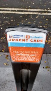 A photo of a branded City Bike rack with Northwell Urgent Care messaging on it.