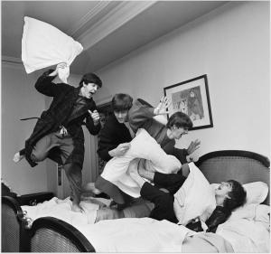 A pillow fight between the Beatles