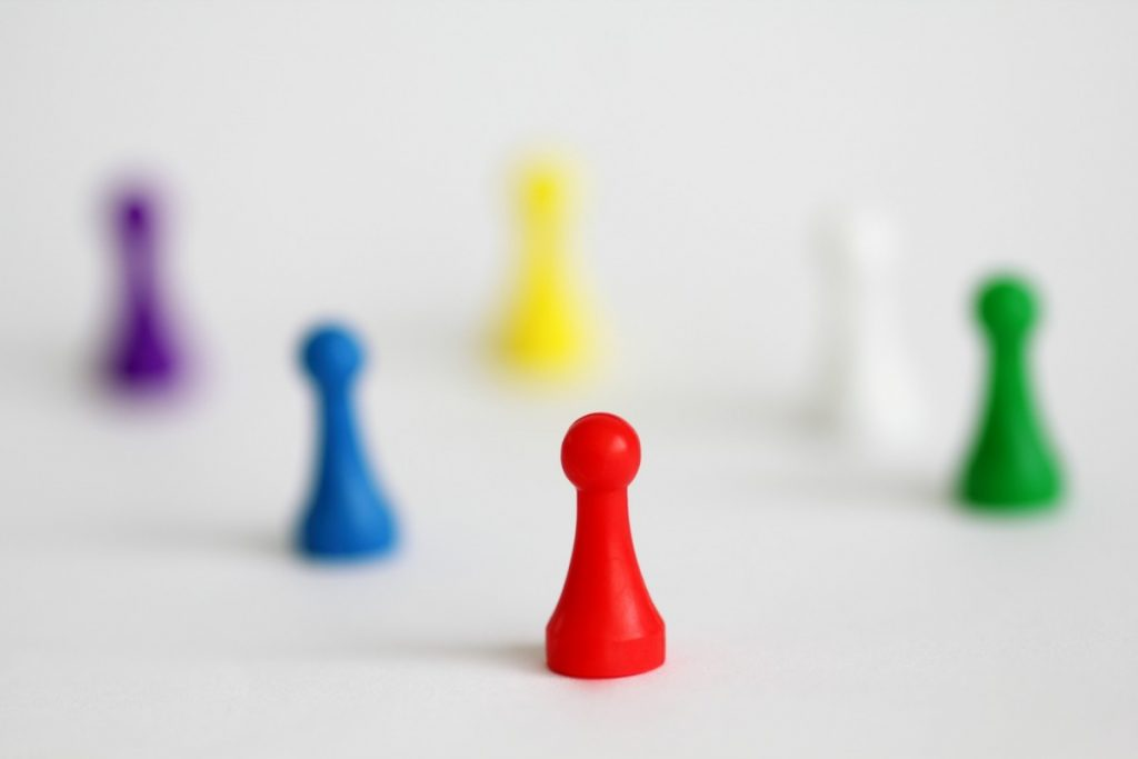 Coloured board game playing figures