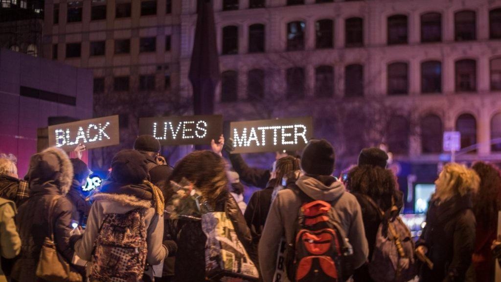 Black Lives Matter in lights at a protest