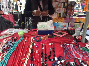 A woman making more of her special handmade jewelry. They go for 15€ and up.
