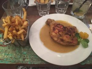 Chicken cooked in finer lemongrass sauce a.d finch fries