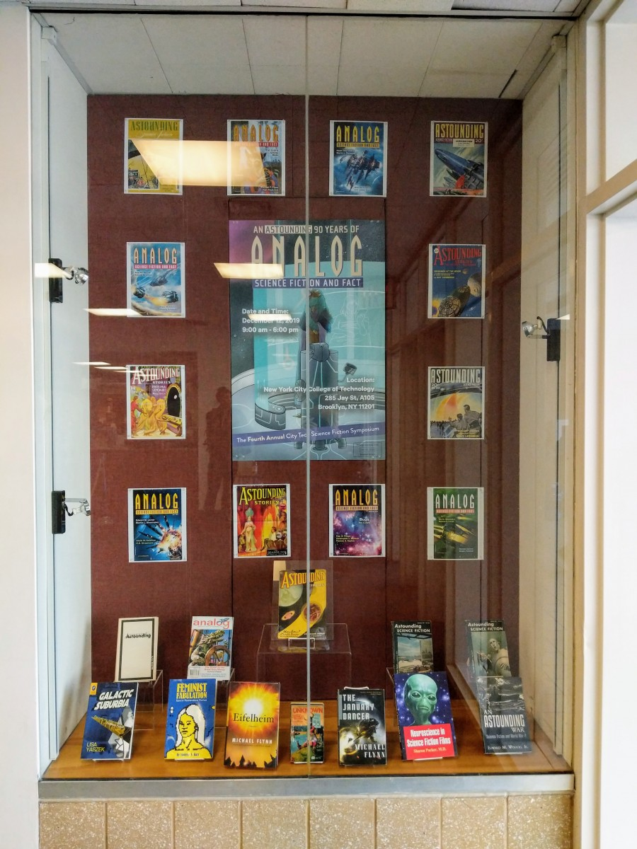 Display case highlighting the published work of speakers at the 4th annual City Tech Science Fiction Symposium.
