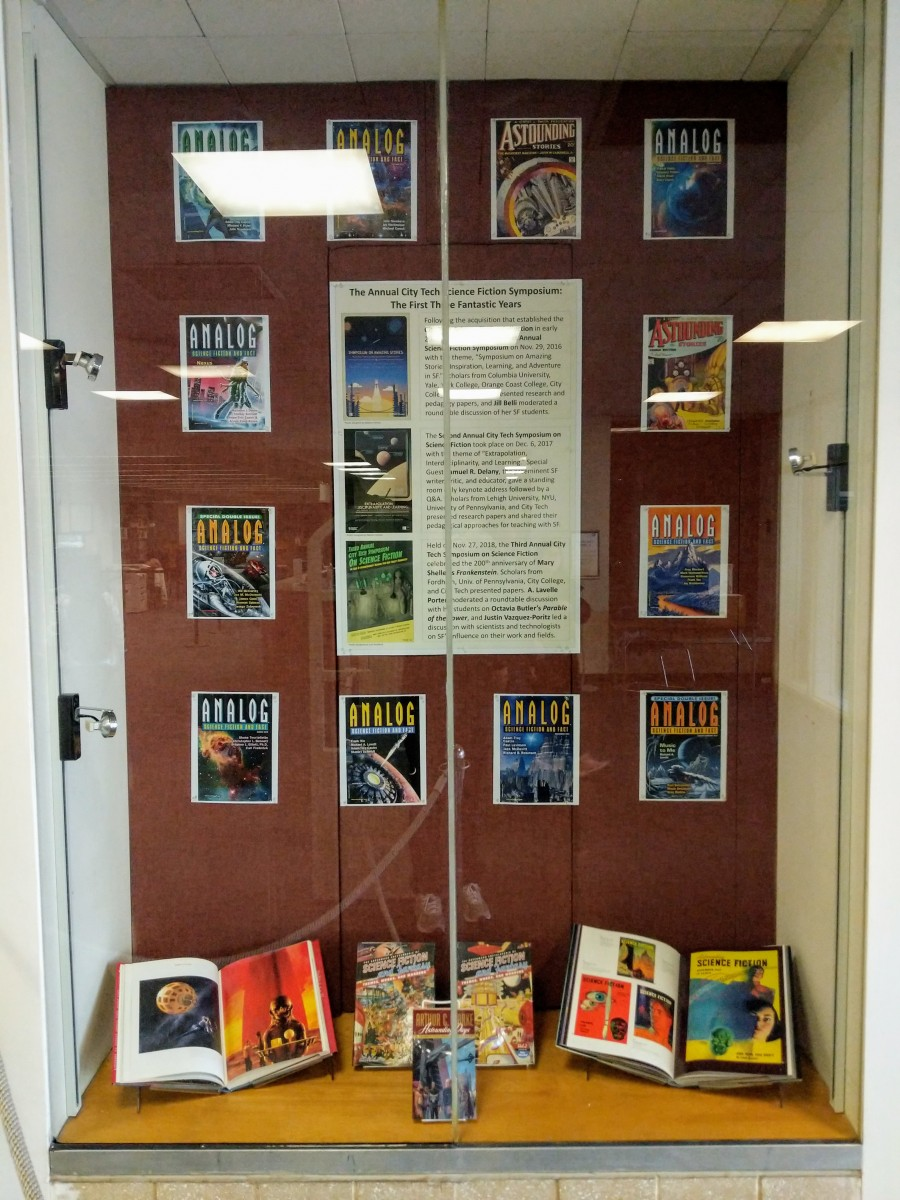 Display case highlighting the history of the annual City Tech Science Fiction Symposium.