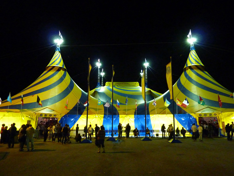 a large yellow-and-blue circus tent