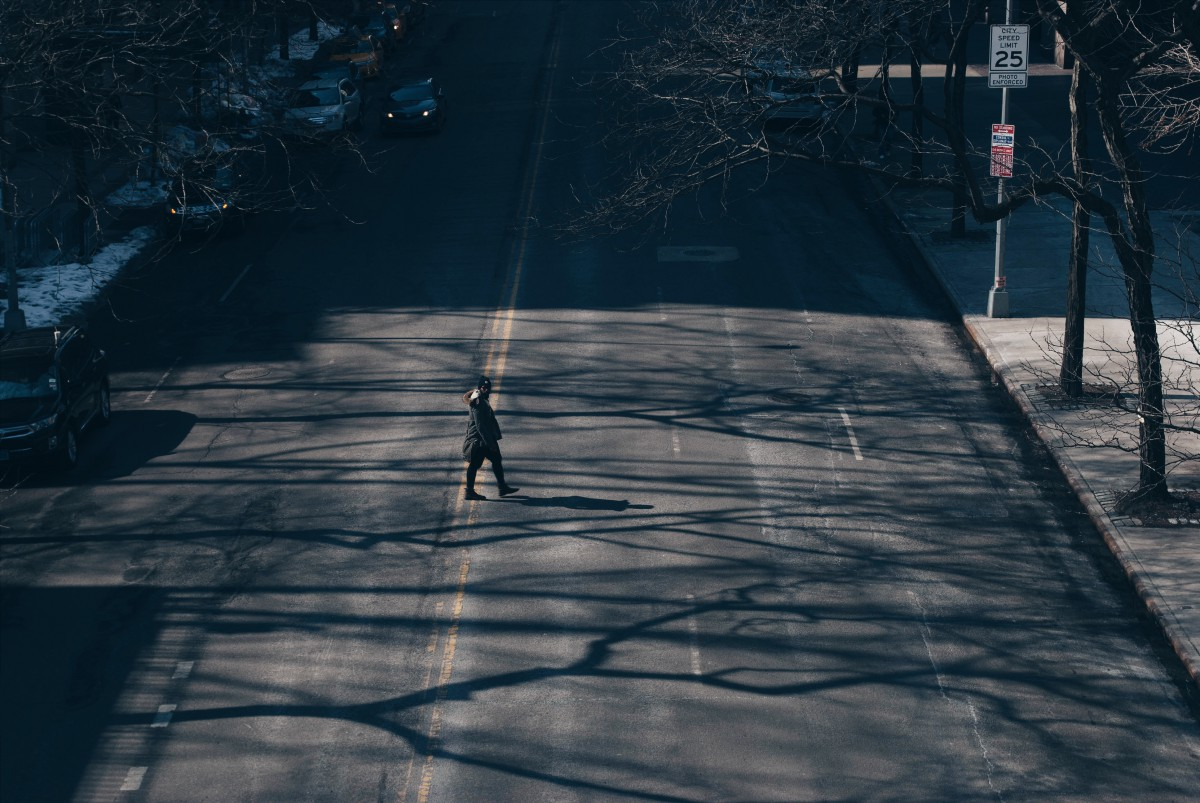 a person walking across a street