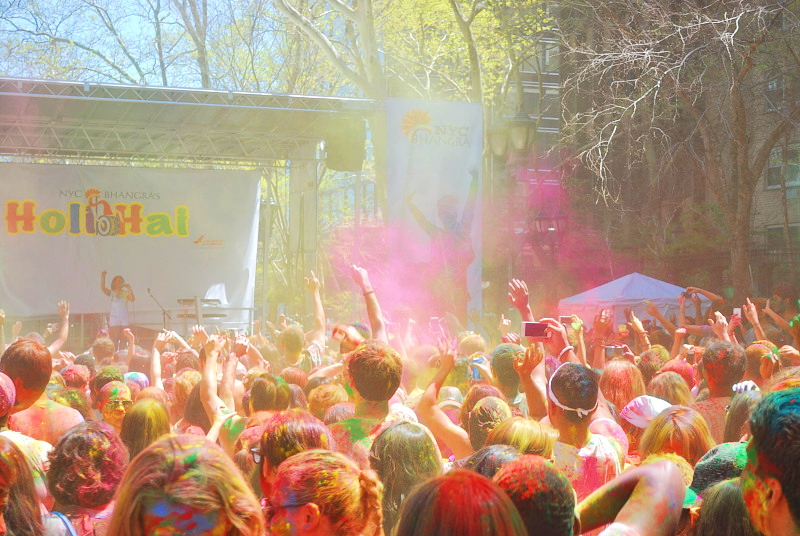 a crowd covered in colors