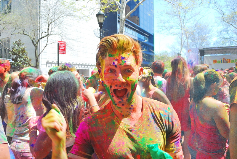 a young man covered in colors