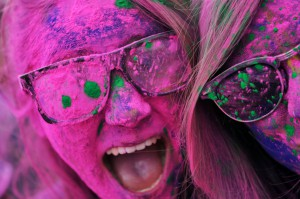 two young women covered in colored paint