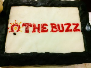 "a decorated cake made for ""The Buzz"" team"