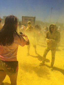 people in clouds of colored, smokey paint