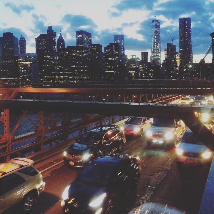 cars on a bridge at night