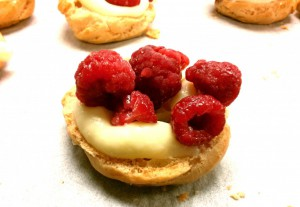 cream puff with vanilla pastry cream and raspberries