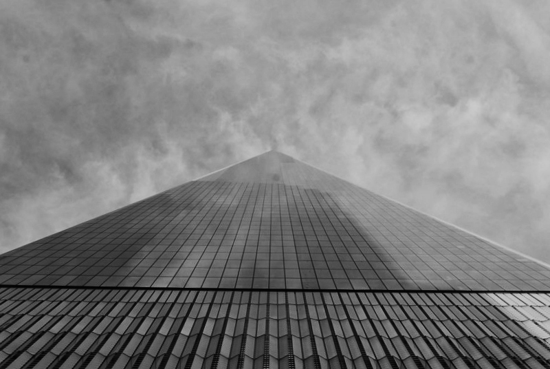 the top of a skyscraper as seen from the ground