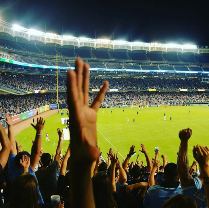 a stadium field with a crowd