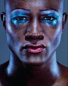a young man wearing glowing make-up