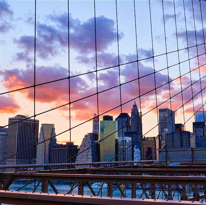 a cloudy sunset over a city skyline
