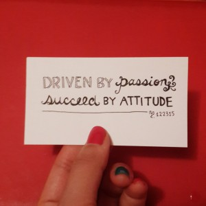 "a card that says ""DRIVEN BY PASSION; SUCCEED BY ATTITUDE"""