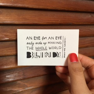 "a card that says ""An eye for an eye only ends up making the whole world blind."""