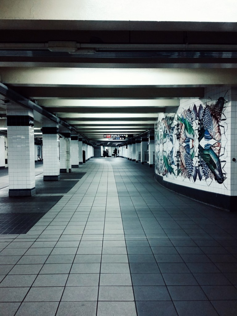 a subway platform with tile art