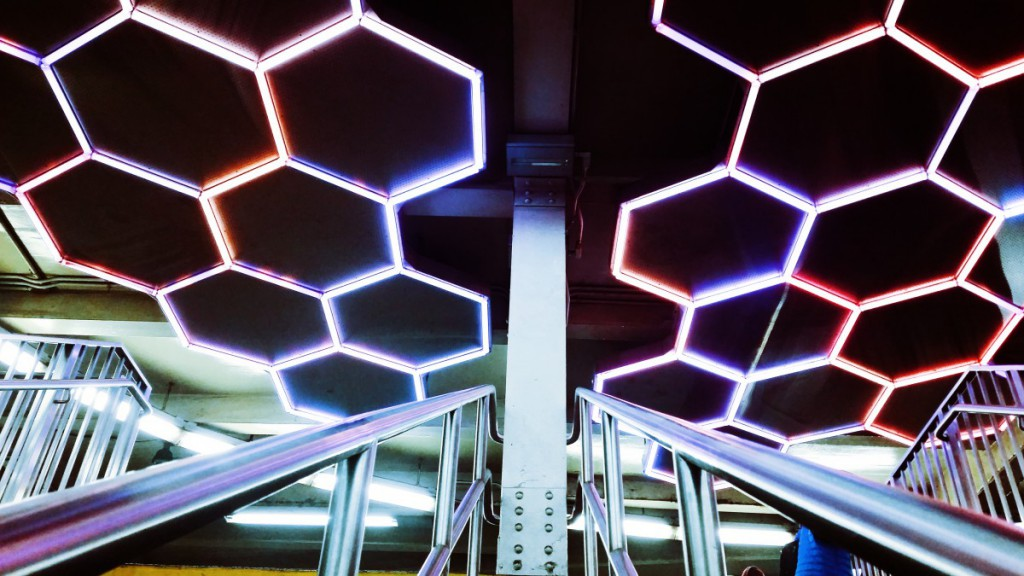 lights in a beehive pattern on a station ceiling