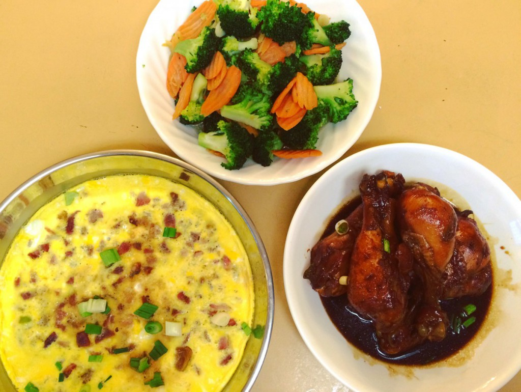 dishes of vegetables and chicken wings