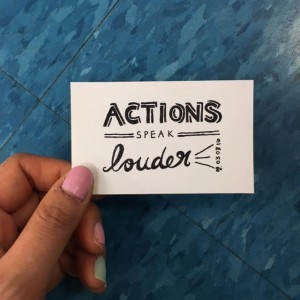"a card that says ""Actions speak louder"""