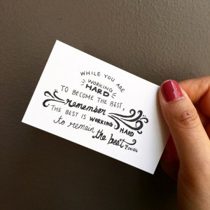 "a card that says ""While you are working hard to become the best, remember the best is working hard to remain the best."""
