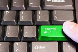 "a green keyboard key that says ""Tomorrow"""