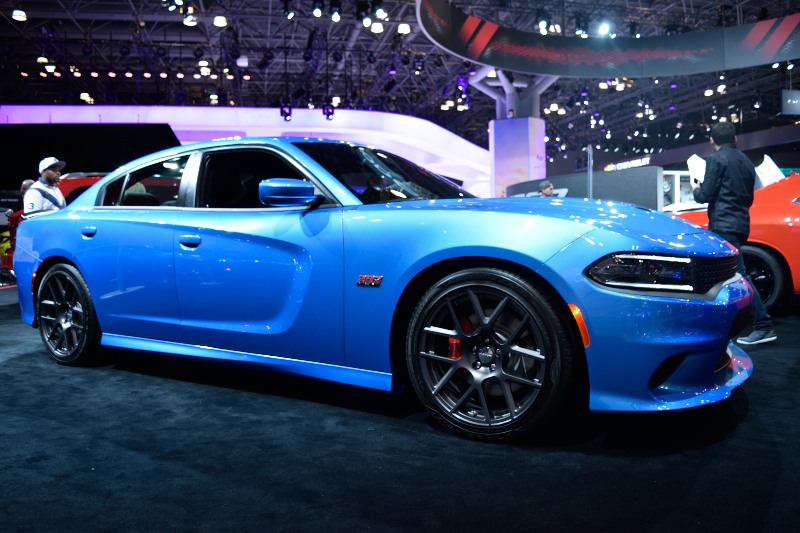 a blue sports car on display