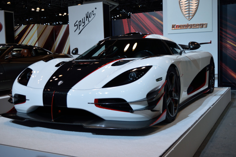 a white sports car with a black stripe down the front