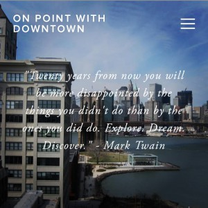 "a city building with the words ""ON POINT WITH DOWNTOWN: 'Twenty years from now you will be more disappointed by the things you didn't do than by the ones you did do. Explore. Dream. Discover.' -Mark Twain"""