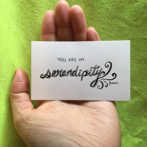 "a hand holding a card that says ""You are my serendipity"""