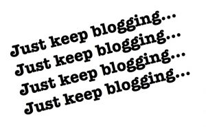 "the words ""Just keep blogging..."" in black letters, four times"