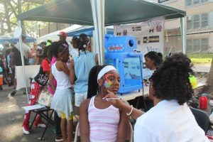 a girl getting her face painted