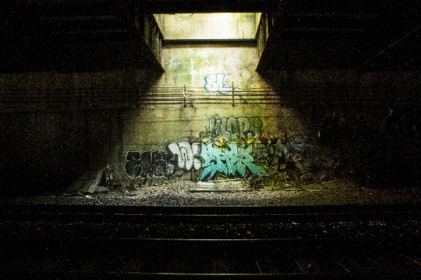 a skylight showing graffiti by train tracks
