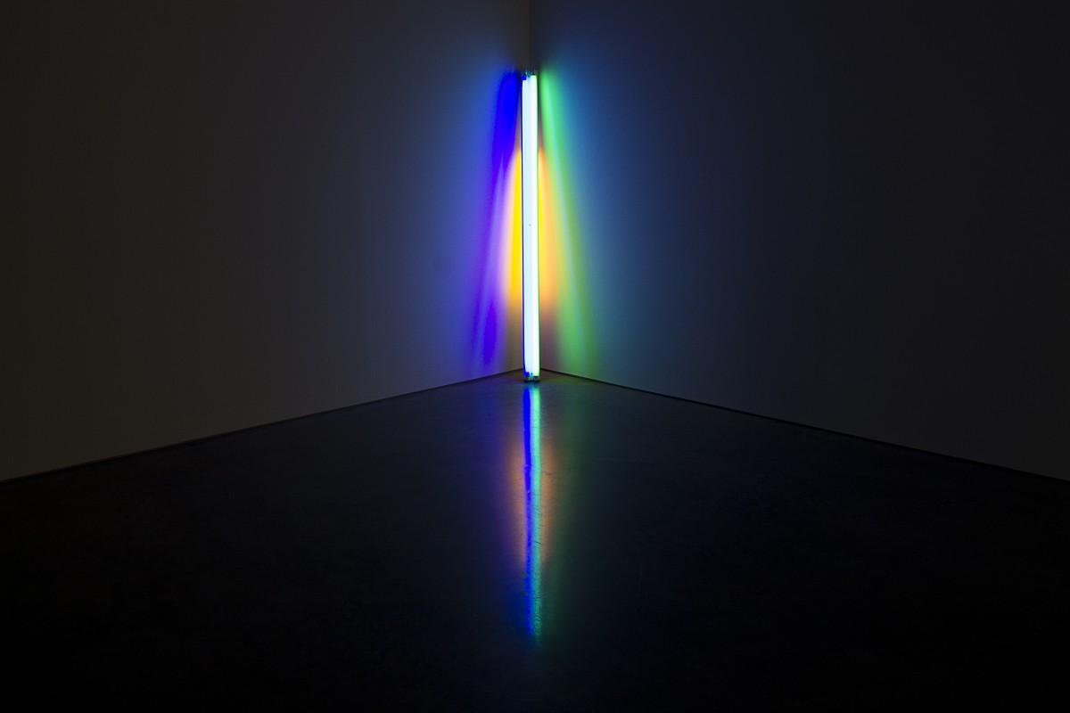 a glowing light stick in an empty room corner