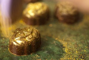chocolate getting covered in gold luster dust