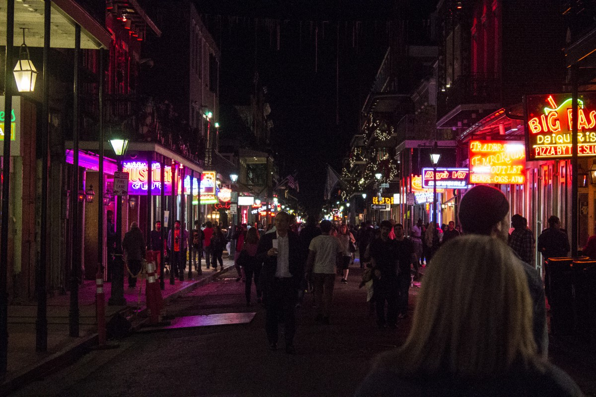 pedestrians on Bourbon Street at night