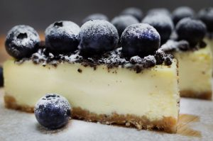 fresh blueberries on top of a plain cheesecake