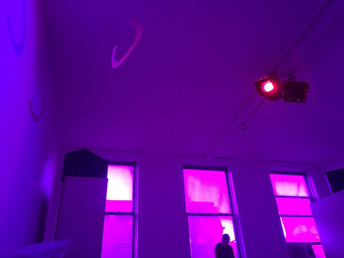 pink-lit windows in a purple-lit room