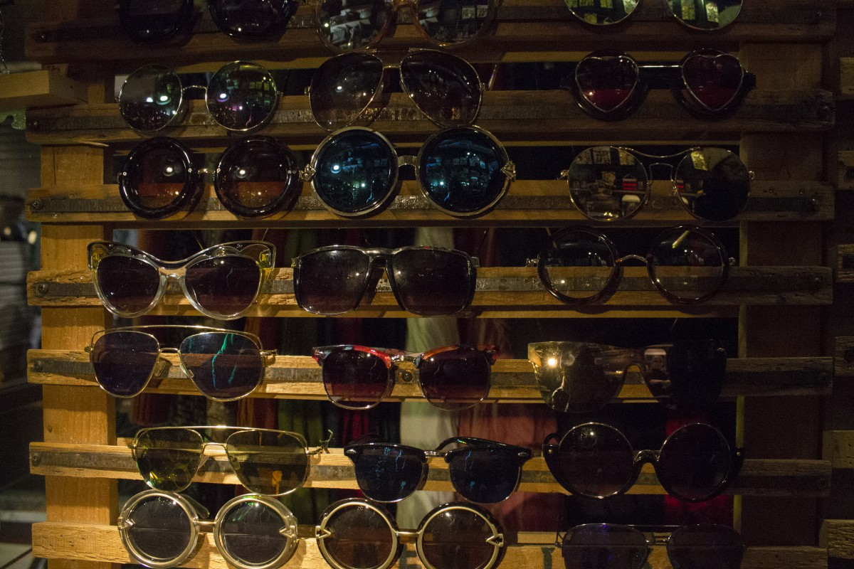 a wall display of sunglasses